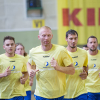 Sweat, laughter and knee-socks: Kielce return to handball